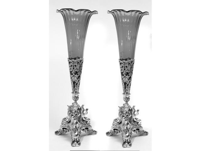 A pair of cranberry glass trumpet vases with plated