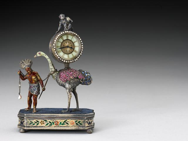 An Austrian sapphire, ruby and pearl embellished silver, silver gilt and enamel miniature desk clock Early 20th century