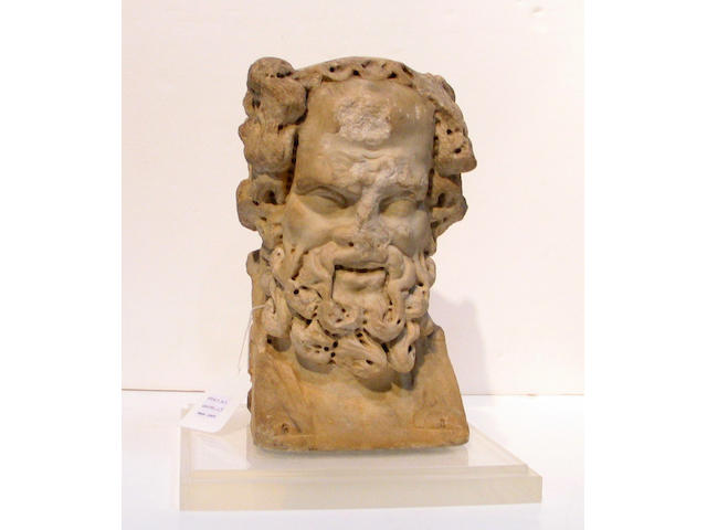A Roman marble bust of Bacchus