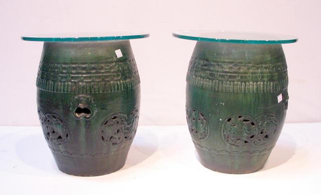 A pair of green glazed pottery garden seats