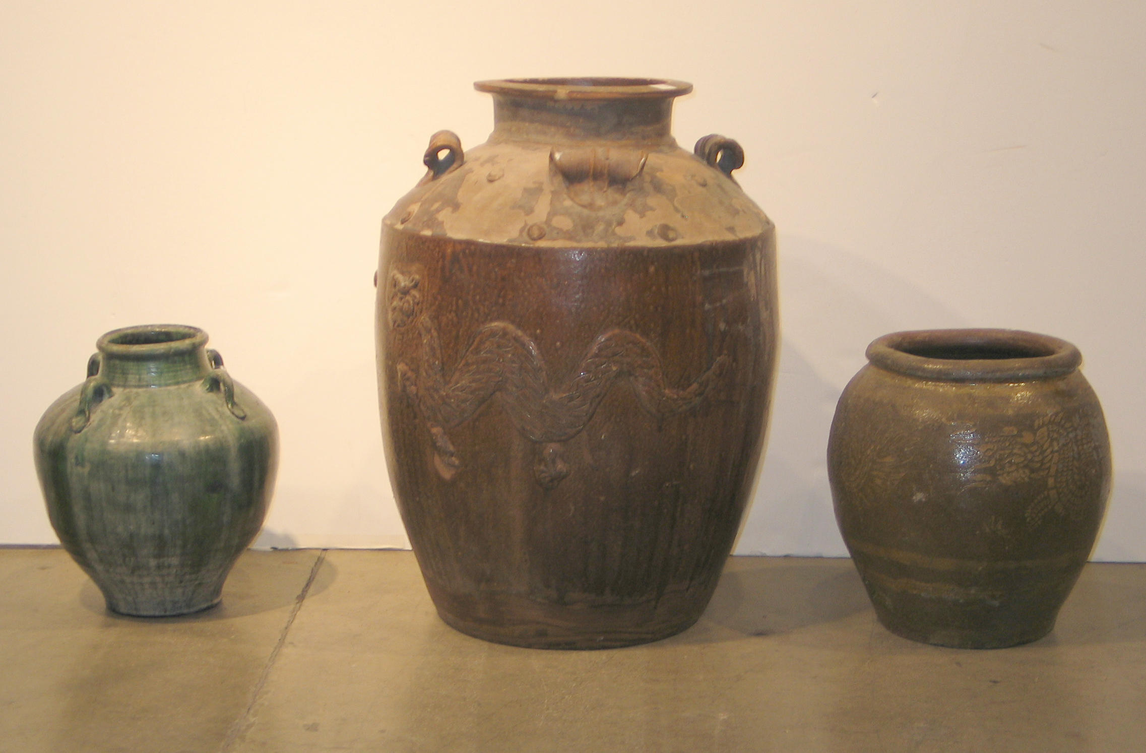 Three glazed pottery trade jars