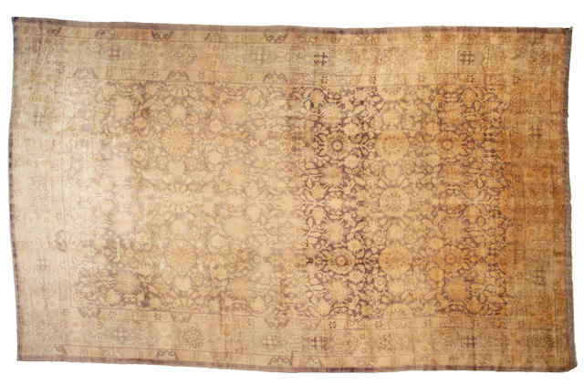 An Oushak carpet West Anatolia, Size approximately 11ft 5in x 18 ft 5in