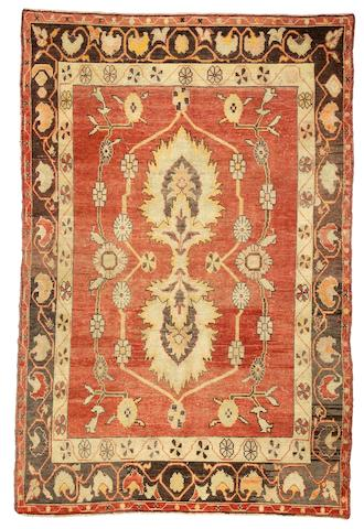 An Oushak rug West Anatolia, Size approximately 5ft 9in x 8ft 7in