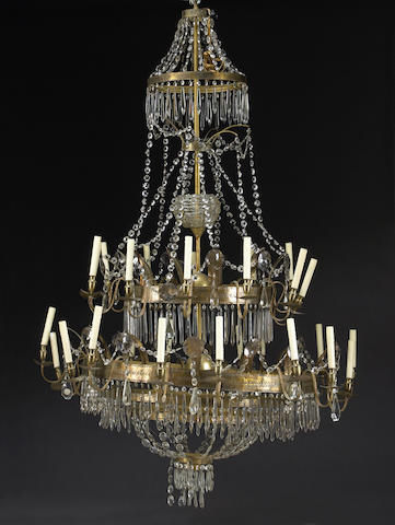 A gilt metal and cut glass monumental three tier chandelier