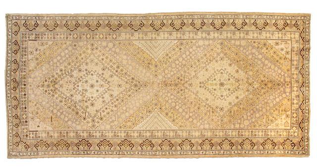 A Khotan carpet Turkestan, Size approximately 6ft 5in x 13ft 7in