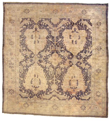 An Oushak carpet West Anatolia, Size approximately 9ft 6in x 10ft 5in