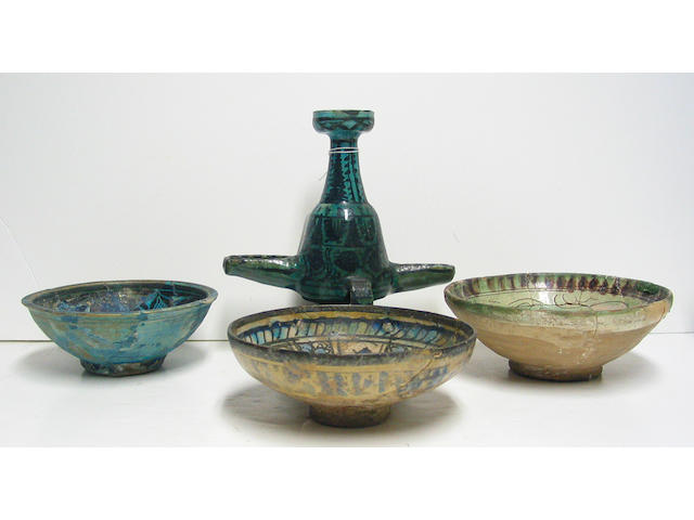 Four Islamic pottery vessels