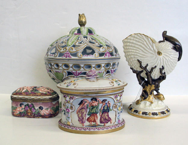 An assembled grouping of ceramics boxes and a vase