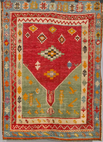 A Turkish rug Size approximately 3ft 6in x 4ft 10 in