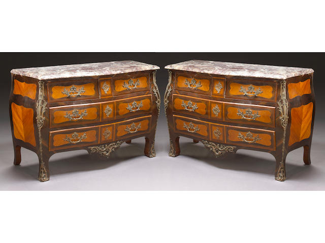 A pair of Louis XV style gilt bronze mounted mahogany commodes