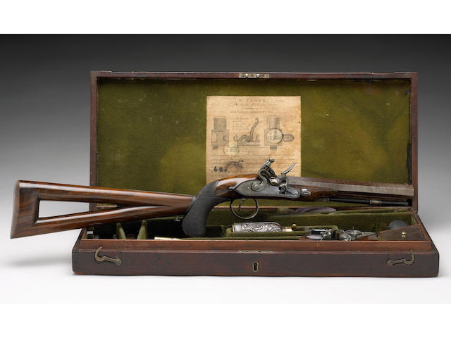 A cased pair of English flintlock pistols by W. Clark
