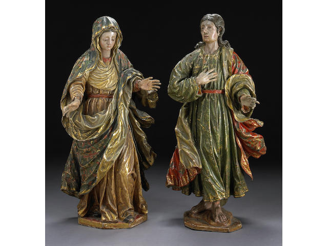 A pair of Spanish Baroque polychrome decorated carved figures of Mary and St. John 17th century