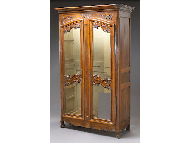 A French provincial fruitwood armoire
