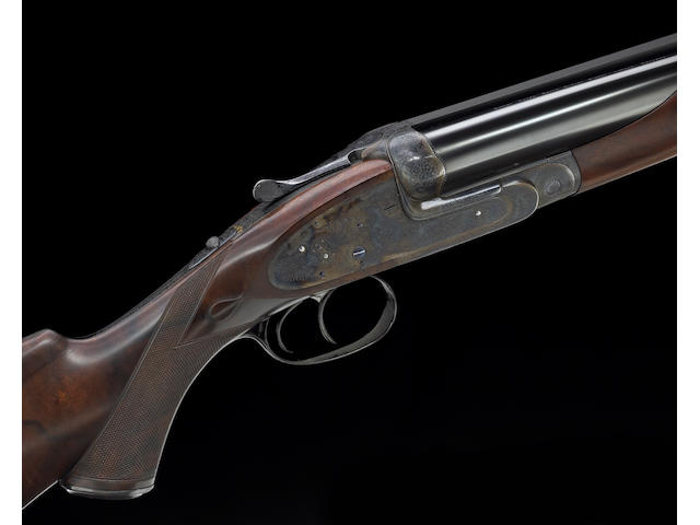 **A rare cased .577 Nitro sidelock ejector double rifle by James Purdey & Son engraved by Ken Hunt.