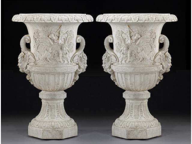 A pair of monumental Neoclassical style white marble urns