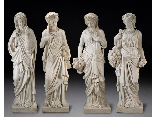 A set of Rococo style marble figures emblematic of The Four Seasons