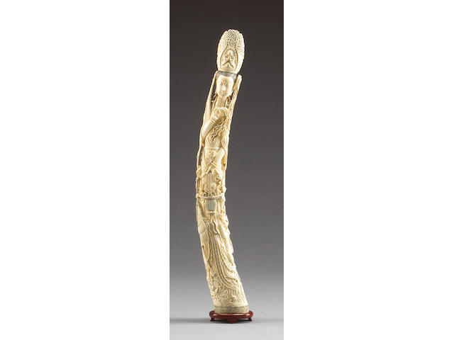 A tall carved ivory Guanyin