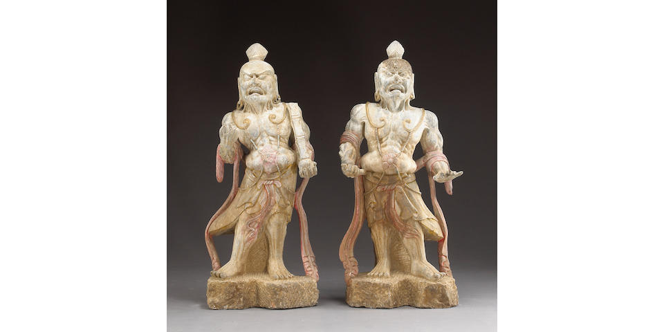 A pair of carved stone guardian figures