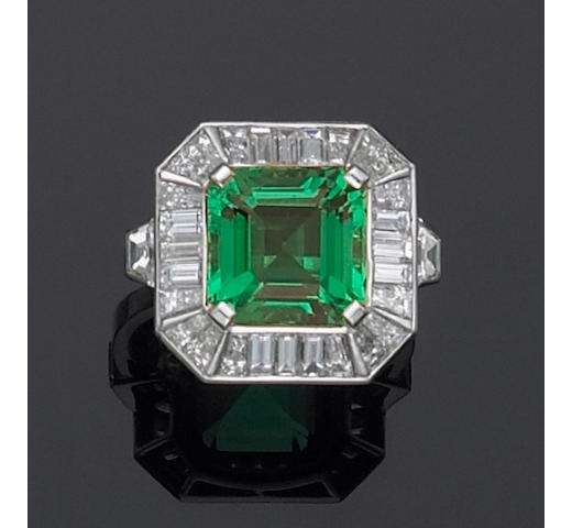 A natural emerald, diamond and platinum ring,