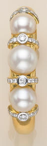 A South Sea cultured pearl, diamond and eighteen karat gold cuff bangle bracelet,
