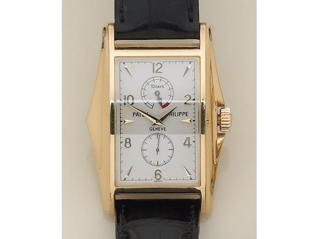 "A Patek Philippe, Geneve, rare gold ""10 Days"" running leather strap wristwatch, reference #5100,"