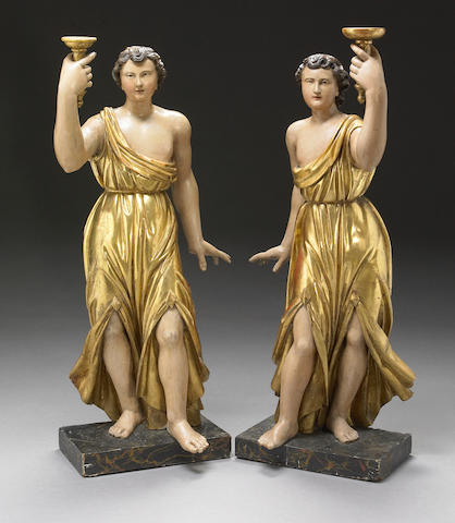 A pair of Continental carved and polychrome figures of angels Possibly Northern Italian 18th century