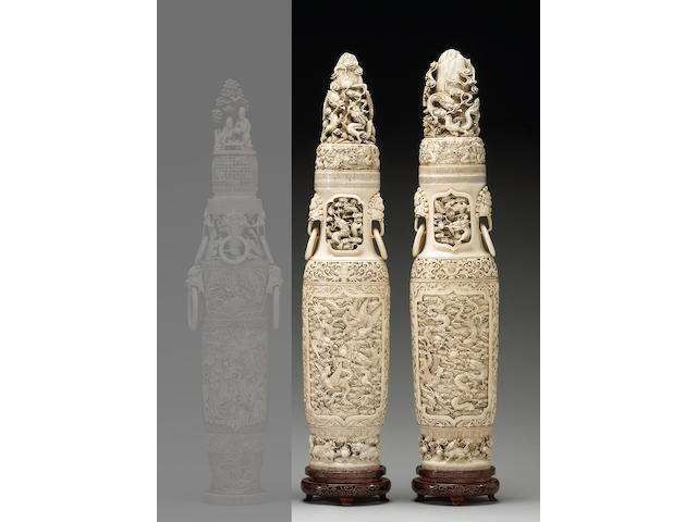 A pair of tall pieced ivory covered urns with dragon and phoenix decoration