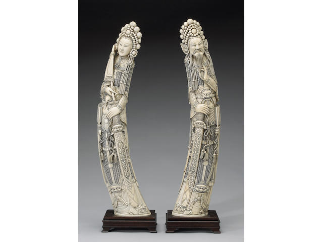 A pair of tinted ivory standing warriors (one chipped)