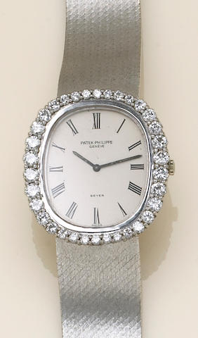 A Patek Philippe, Geneve white gold, diamond, self-winding integral bracelet wristwatch, reference #3595/1