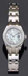 "A lady's Rolex, Geneve ""Oyster Perpetual Datejust"" white gold and diamond, self-winding bracelet wristwatch,"
