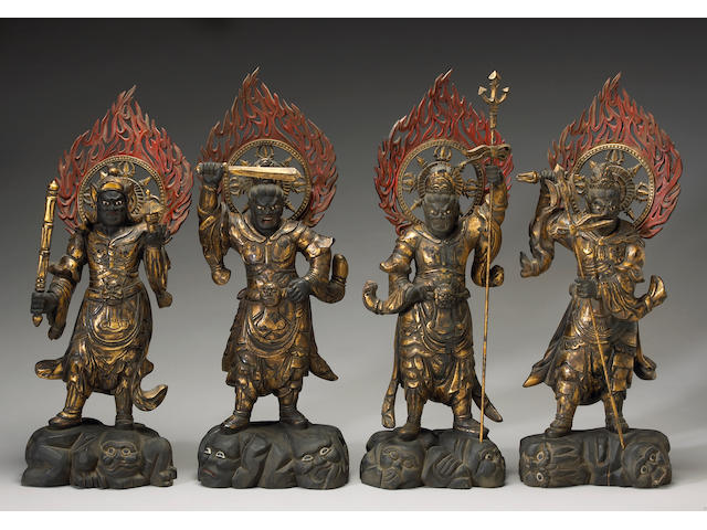 Four gilt wood lacquered Buddhist guardian figures