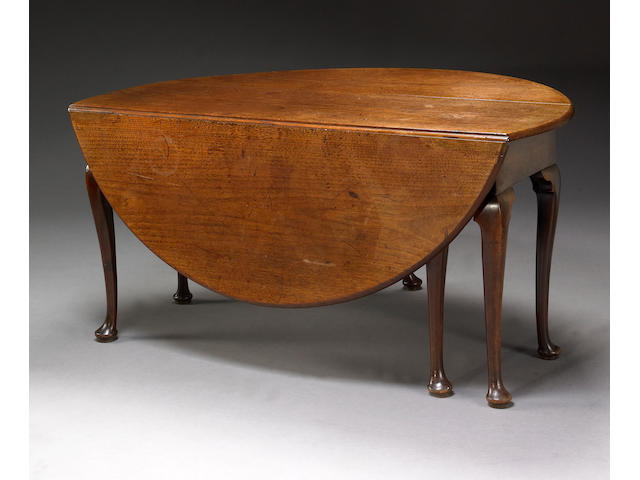 A George II mahogany drop flap dining table