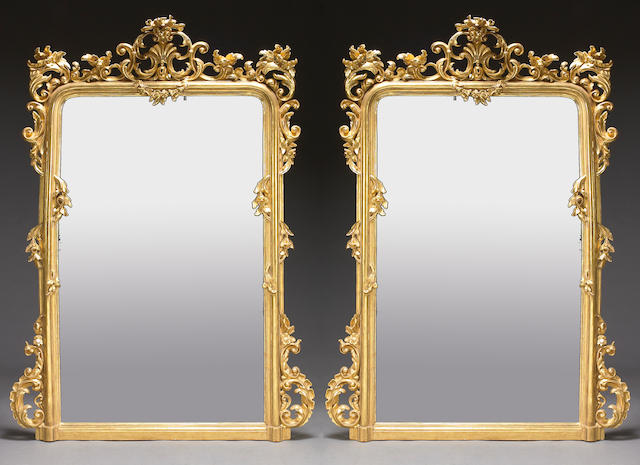 A pair of imposing Italian Rococo style carved giltwood mirrors Second half 19th century