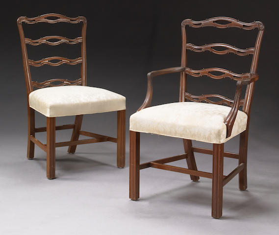 A set of eight George III style carved mahogany dining chairs First quarter 20th century