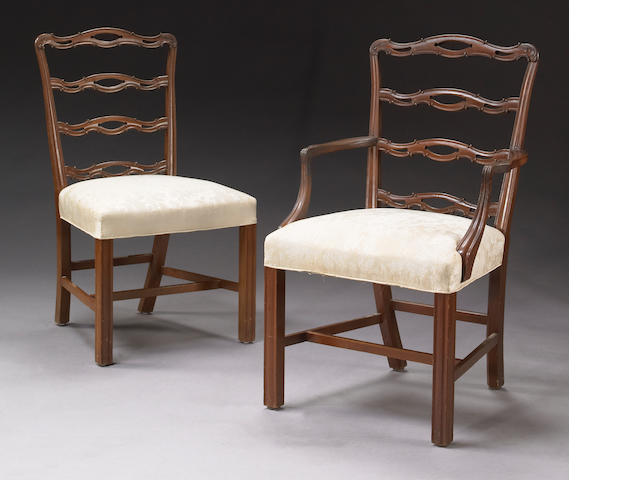 A set of eight George III style carved mahogany dining chairs<br><i>First quarter 20th century</i>