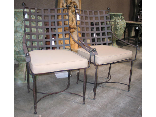 A suite of ten patinated metal Thomas Bartlett armchairs