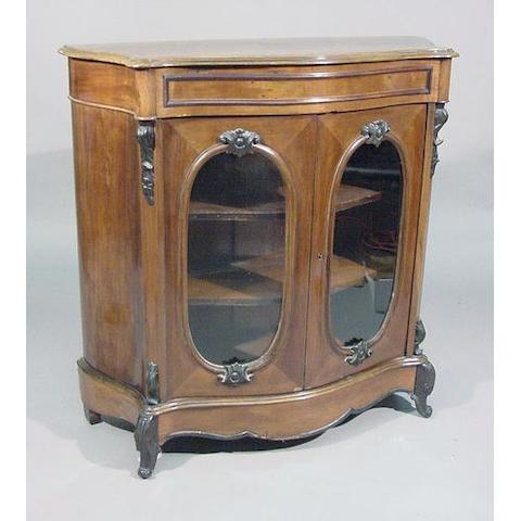 A carved walnut display cabinet