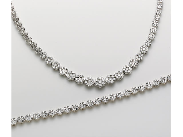 A set of diamond and 14k white and yellow gold jewelry including a necklace and bracelet