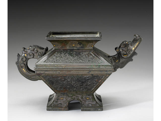 A gilt and cast bronze vessel with  dragon-form handle and spout, Song dynasty