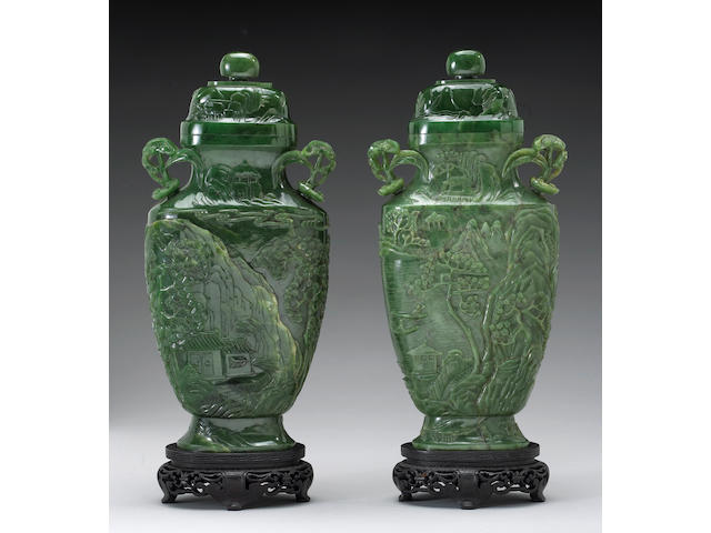 A pair of fine spinach jade covered vases