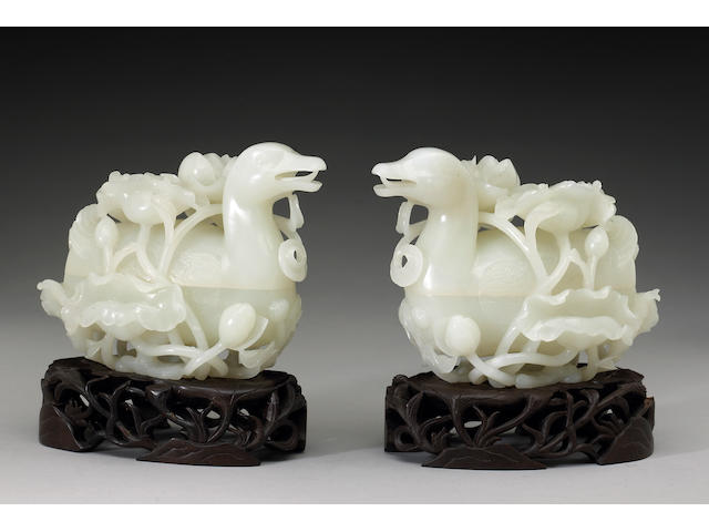 A pair of white jade duck form boxes