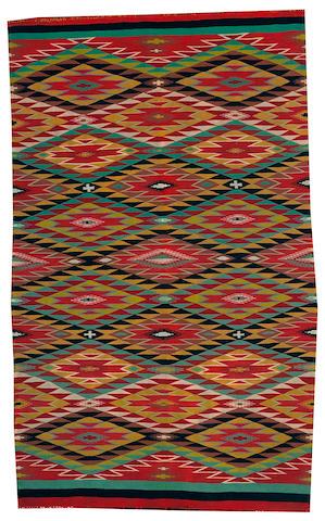 A Navajo Germantown rug, 4ft 8in x 2ft 10in<