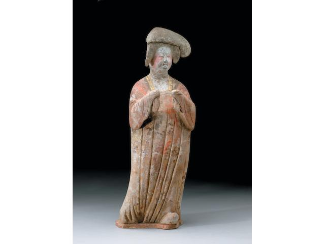 A rare large painted red pottery figure of a court lady