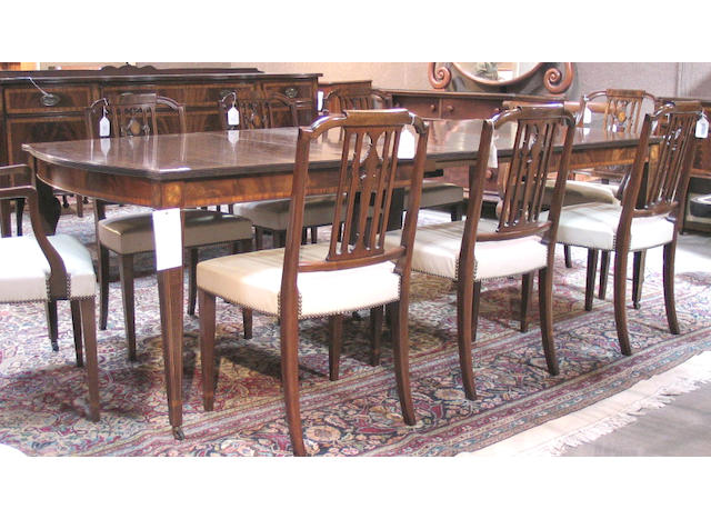 A Federal style inlaid mahogany dining suite comprising a table with four leaves, a sideboard, two armchairs and six side chairs