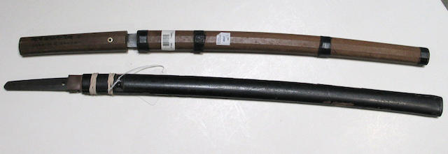 Two katana: one in shirasaya, signed; the other in black lacquer saya lacking tsuka