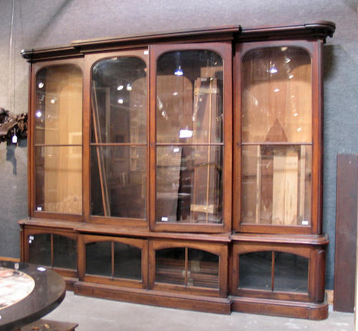A Victorian walnut bookcase cabinet