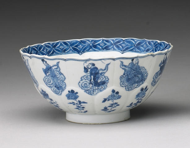 A blue and white porcelain bowl with molded panels <i>Transitional to Kangxi Period</i>
