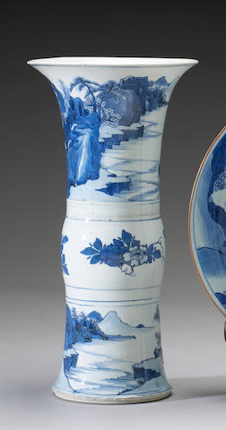 A blue and white porcelain beaker vase <i>Kangxi Period, Mushi Wangshi Mark</i>
