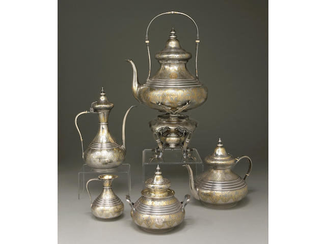 A French parcel-gilt 950 standard silver four piece tea and coffee set with plated matching kettle on