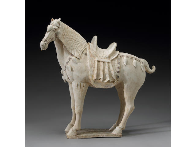 A fine unglazed model of a horse <i>Tang Dynasty</i>
